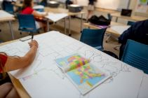 Student drawing a map